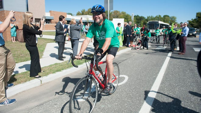 Major Bill Dunigan with the Kroc Center, rides the bike route on Harrison Ave. as a new Camden Greenway and circuit bike trail project is unveiled in front of the Kroc Center on Harrison Ave. in Camden. Thursday, September 24, 2015.