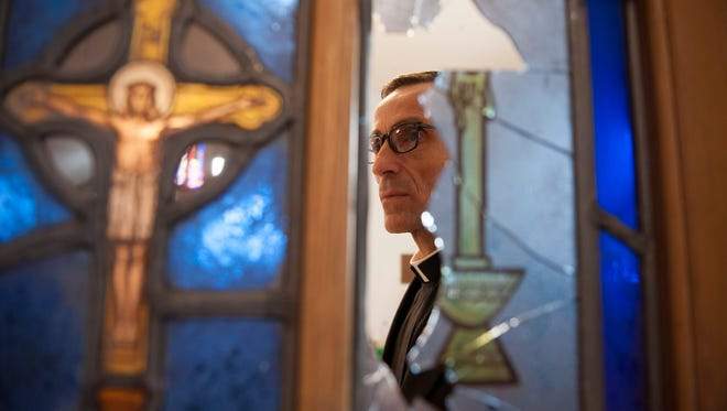Rev. Joe Capella, of Our Lady of Guadalupe Parish Shrine in Lindenwold, surveys the damage following the vandalism that occured yesterday afternoon. Thursday, January 7, 2016.