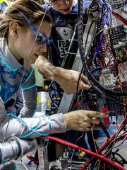 Junior Patience Simes checks the electrical wiring before a practice run at the Smoky Mountain Regional.