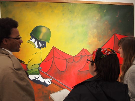 Students observe work by David Giffey at the Caestecker Gallery, C.J. Rodman Center for the Arts, Ripon College. This piece is one of several Giffey created from his memories of Vietnam.