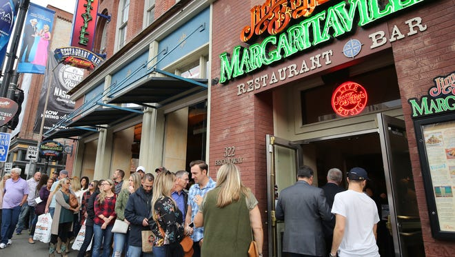 Fans line up and wait to get into Margaritaville for Buzz Brainard's Music Row Happy Hour show on Sirius XM's The Highway Friday October 27, 2017.