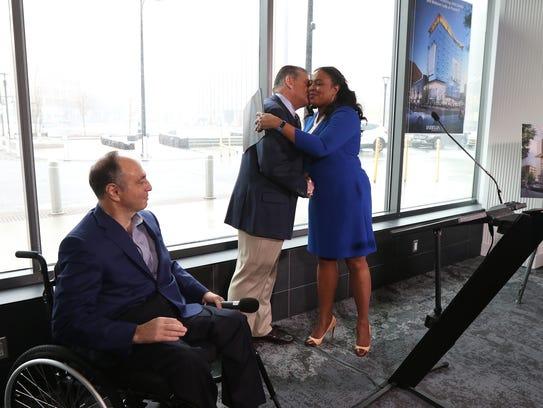 Rochester Mayor Lovely Warren hugs Arnold Rothschild,