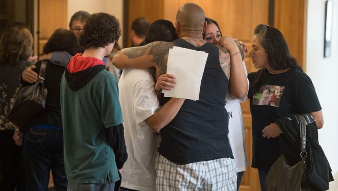 Family of Raelynn Martinez meet outside the courtroom following the sentencing of Juan Canales-Hernandez on Thursday, April 5, 2018. Canales-Hernandez was sentenced to life in prison without the possibility for parole in the death of the 11-month-old.