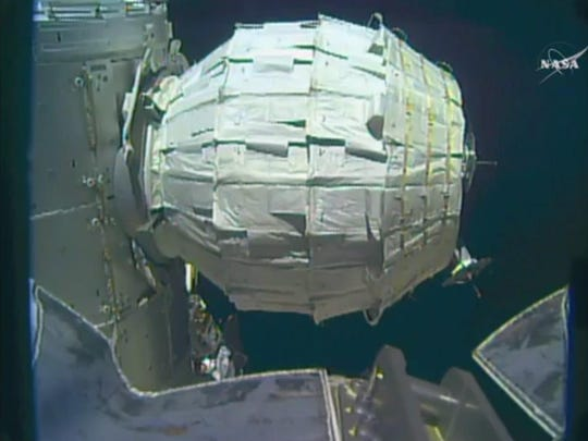 This image made from video provided by NASA shows the inflation of a new experimental room at the International Space Station on Saturday. Saturday was NASA's second shot at inflating the Bigelow Expandable Activity Module (BEAM), named for the aerospace company that created it.