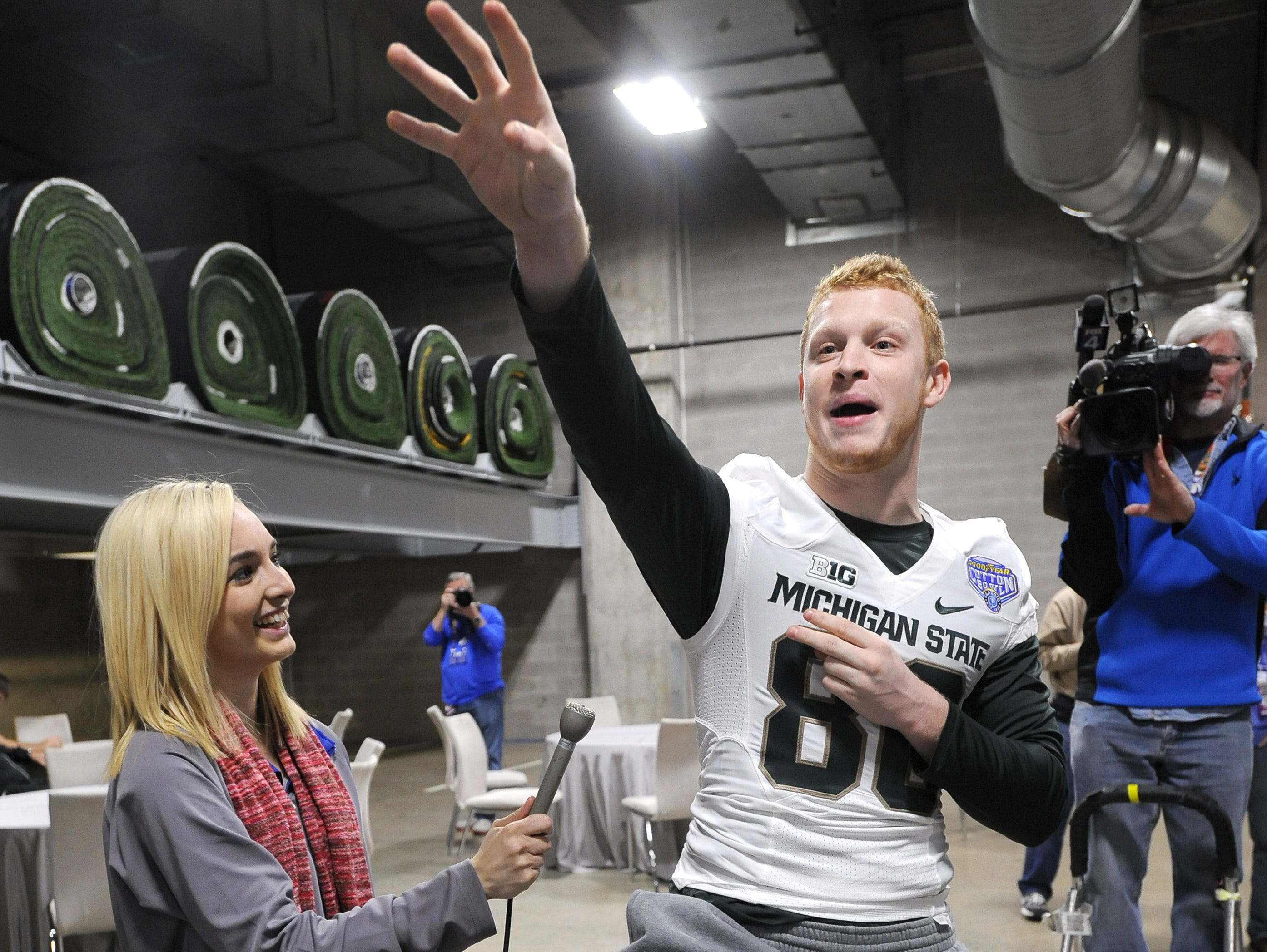 MSU's Matt Macksood cracks up the audience and his teammates with impersonations of MSU football coaches, including assistant Mike Tressel, during Cotton Bowl Classic media day on Dec. 30, 2014.