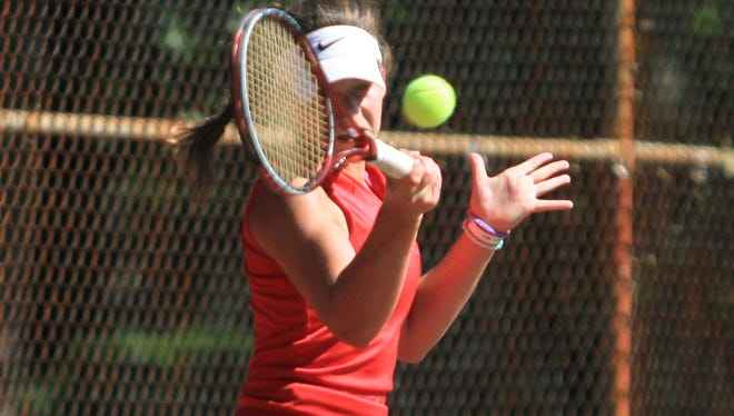 Manalapan's junior, Keren Khromchenko, takes a swing, during the Monmouth County Tennis Tournament at Tindall Park in Middletown, Sunday, September 22, 2013