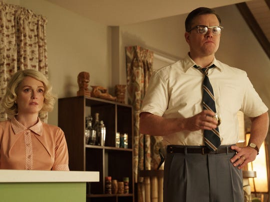 "Julianne Moore, left, and Matt Damon in ""Suburbicon,"" about a 1950s suburb with a violent and racist underbelly."