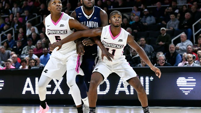 Feb. 14: Providence forward Rodney Bullock, left, and guard Alpha Diallo, right, box out Villanova forward Eric Paschall, middle, on a free throw during the first half at the Dunkin Donuts Center in Providence.