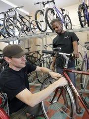 Mark Fluette, left, owner of Active Bike & Fitness,