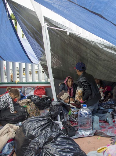 About a dozen tents have been set up on the cement outside the entrance gate to the San Ysidro port of entry providing some protection from cloudy skies and intermittent rain on May 1, 2018. Volunteers from organizations in Tijuana continue to drop off food, water, diapers, and clothing.