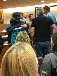 Senior Deputy District Attorney Rebecca Day hugs Gail