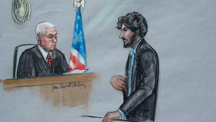 In this courtroom sketch, Boston Marathon bomber Dzhokhar Tsarnaev, right, stands before U.S. District Judge George O'Toole Jr. as he addresses the court during his sentencing, Wednesday, June 24, 2015, in federal court in Boston.