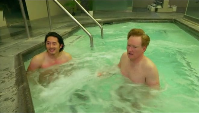 Conan and 'The Walking Dead's' Steven Yeun strip down and spend the day together at an authentic Korean spa.