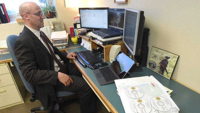 Deputy District Attorney Keith Stein views one of several videos from police officers' body cameras while working on a case out of Lebanon.
