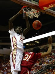 Christ Koumadje (21) dunks on Winthrop's Tevin Prescott