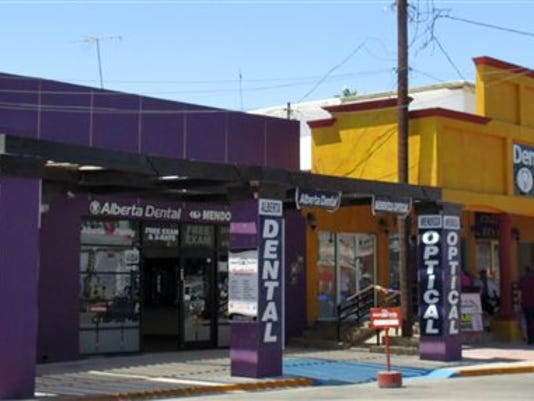 In this Thursday, April 30, 2015 photo, a street full of a dental offices is seen in Los Algodones, Mexico, which sits on the border with California.