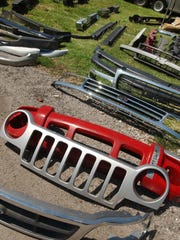A variety of grilles and bumpers were among the auto accessories for sale at a previous swap meet.