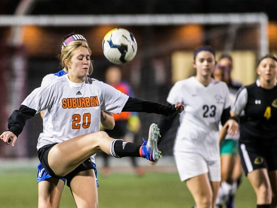 Paige Linden (20) of York Suburban corales the ball
