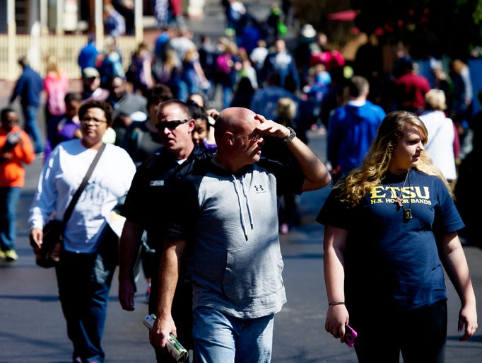 Visitors meander during opening day at Dollywood in