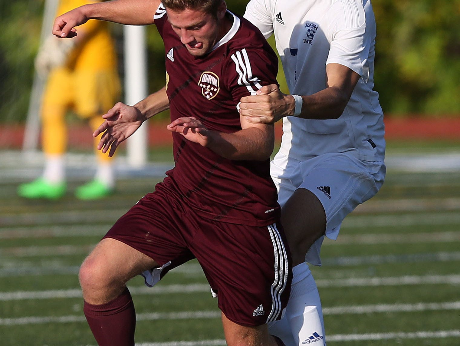 From left, Arlington's A.J. Ramputi (7) and Mahopac's Christian Shkreli (7) battle for ball control during a boys soccer game at Mahopac High School Oct. 8, 2015. Arlington won the game.