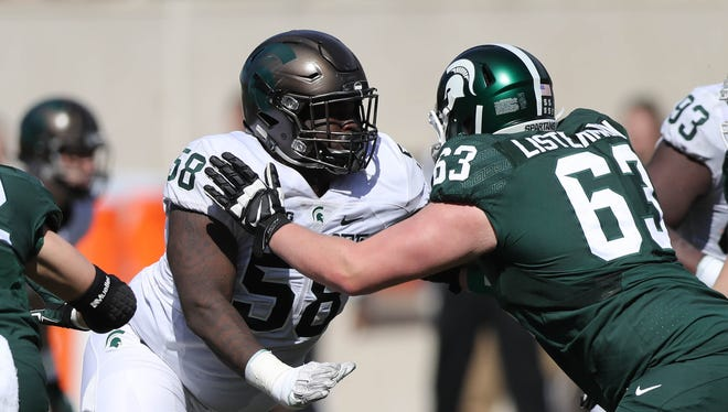 Michigan State defensive tackle Devyn Salmon rushes against tackle Noah Listermann during the spring game at Spartan Stadium, Saturday, April 1, 2017.