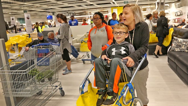 """Amanda Craft and her """"shopping buddy,"""" Parker Craft, her son, shop at the IKEA Fishers grand opening, Wednesday, Oct. 11, 2017."""