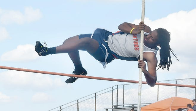 A Beau Chene pole vaulter clears the bar on Thursday during the 13-team Eunice High Bobcat Relays. The Gators had two of the three top finishers in the event. John Guidry vaulted 12 feet and John Henry placed third at 8-6.