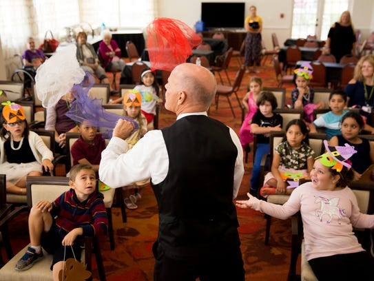 Magician Gerard Tricarico juggles while performing