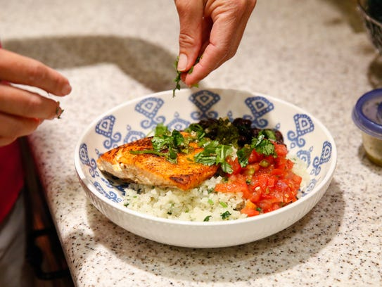 Anna Jones adds the finishing touches to the mojo salmon