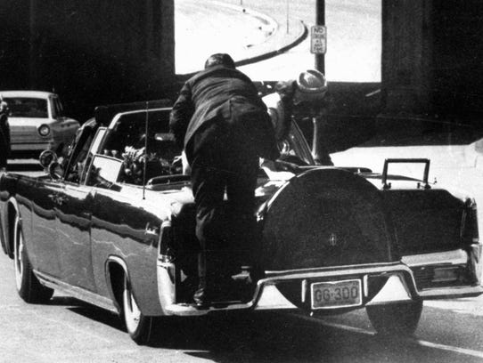 Jacqueline Kennedy, right, and a Secret Service agent react to the shooting of then-President John F. Kennedy.