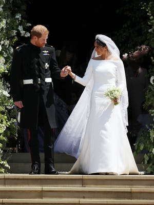 Meghan Markle, now the Duchess of Sussex, wore a bonded silk Givenchy bridal gown with bateaux neckline and a 16.5-foot veil embroidered with flowers from all the commonwealth countries.