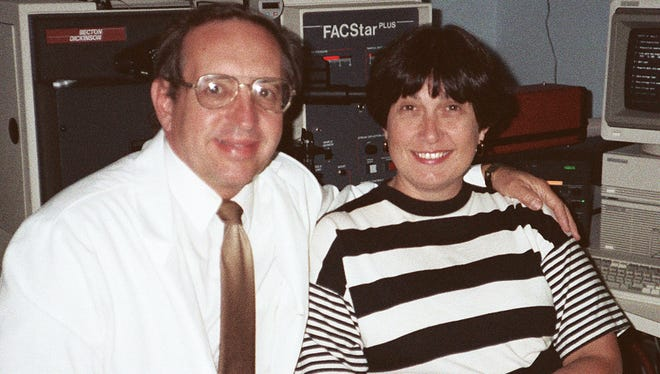 Andy and Carol Tometsko in the lab at Litron Laboratories Ltd. in Brighton, a company they co-founded. Andy died in 1994 but the company has endured and thrived under Carol's leadership and celebrated its 40th anniversary last week.