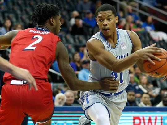 Seton Hall Pirates guard Shavar Reynolds (21) drives to the basket against NJIT