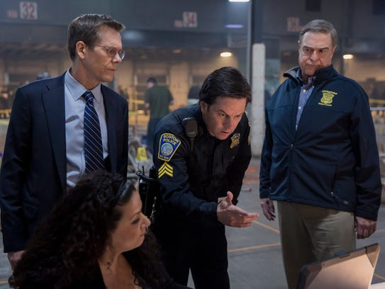 In this image released by CBS Films, Kevin Bacon, standing