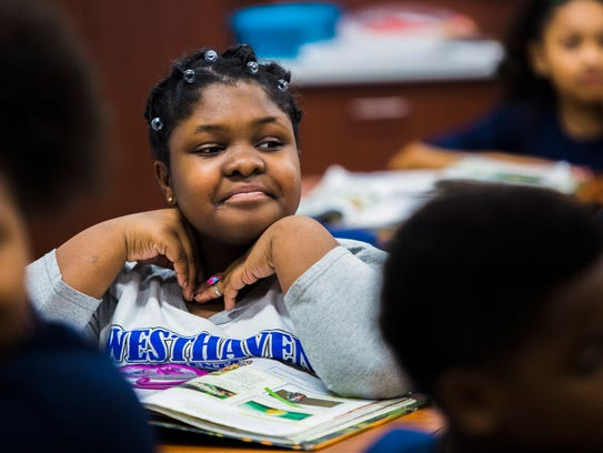 Kennedy Lewis, 10, listens to her fourth grade teacher,