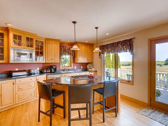 A cook-top island is in the kitchen of the home at