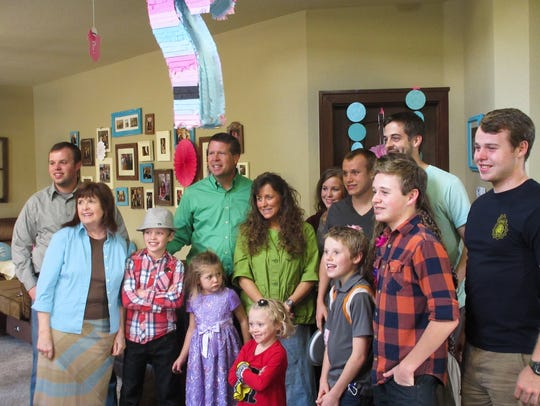 The Duggar family poses by a piñata for the ninth season