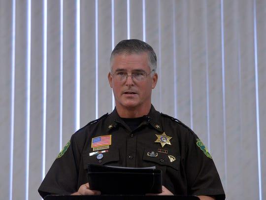 Sheriff Bob Edwards reads a prepared apology letter