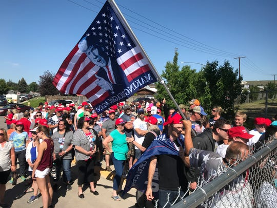 People wait for the gates to open at Montana ExpoPark ahead of President Donald Trump's campaign rally at the Four Seasons Arena in Great Falls on Thursday, July 5, 2018.