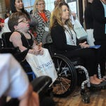 Kendra Gottsleben, Vicki Harkness and others listen during a news conference to publicly commemorate the 25th anniversary of the signing of the Americans with Disabilities Act on July 13 at the Hilton Garden Inn Downtown Sioux Falls, S.D.