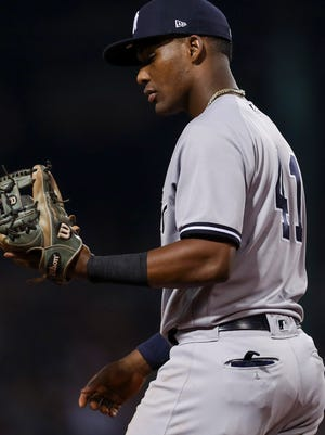 New York Yankees third baseman Miguel Andujar (41) looks at his glove after committing an error against the Boston Red Sox at Fenway Park.