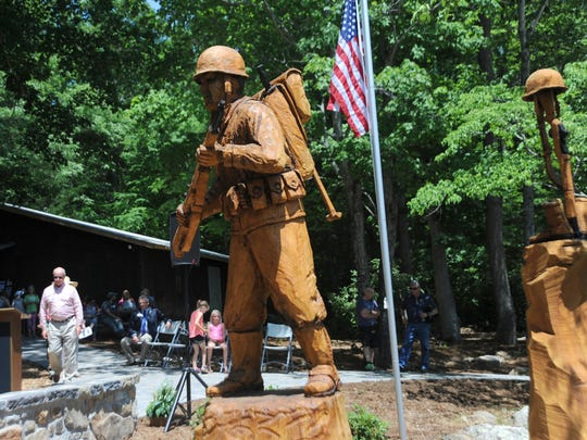 An intricately carved wooden statue on the West Campus of the Black Mountain Home for Children was dedicated in honor of the late Andy Andrews on June 3.