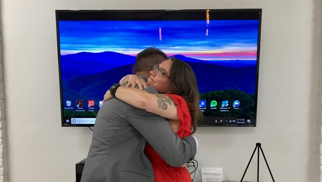 Chris Cain, executive director of Staunton Innovation Hub, gives Christopher Wood, executive director of LGBT Tech, a hug after Wood announces the opening of the Shenandoah LGBTQ Center on Friday, July 13, 2018.