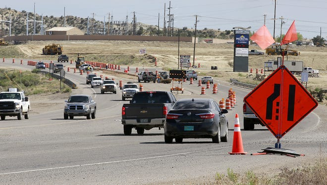 Traffic slows as construction continues May 11 on the East Aztec Arterial Route off U.S. Highway 550, south of Aztec. The Aztec City Commission on Tuesday approved an application to acquire 10 acres of land, currently owned by the Bureau of Land Management, for the project.