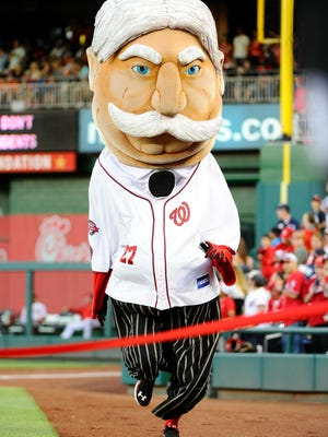"""The Washington Nationals mascot """"President Taft"""" runs on the field during the Nationals' game against the Philadelphia Phillies at Nationals Park in May of 2015."""