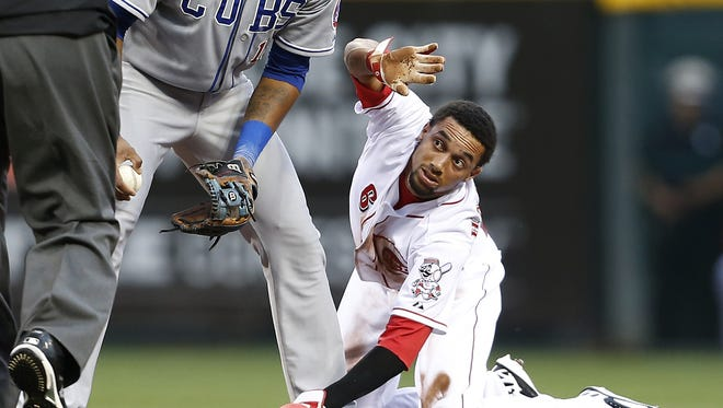 Cincinnati Reds center fielder Billy Hamilton (6) calls time out after stealing second base against the Chicago Cubs.