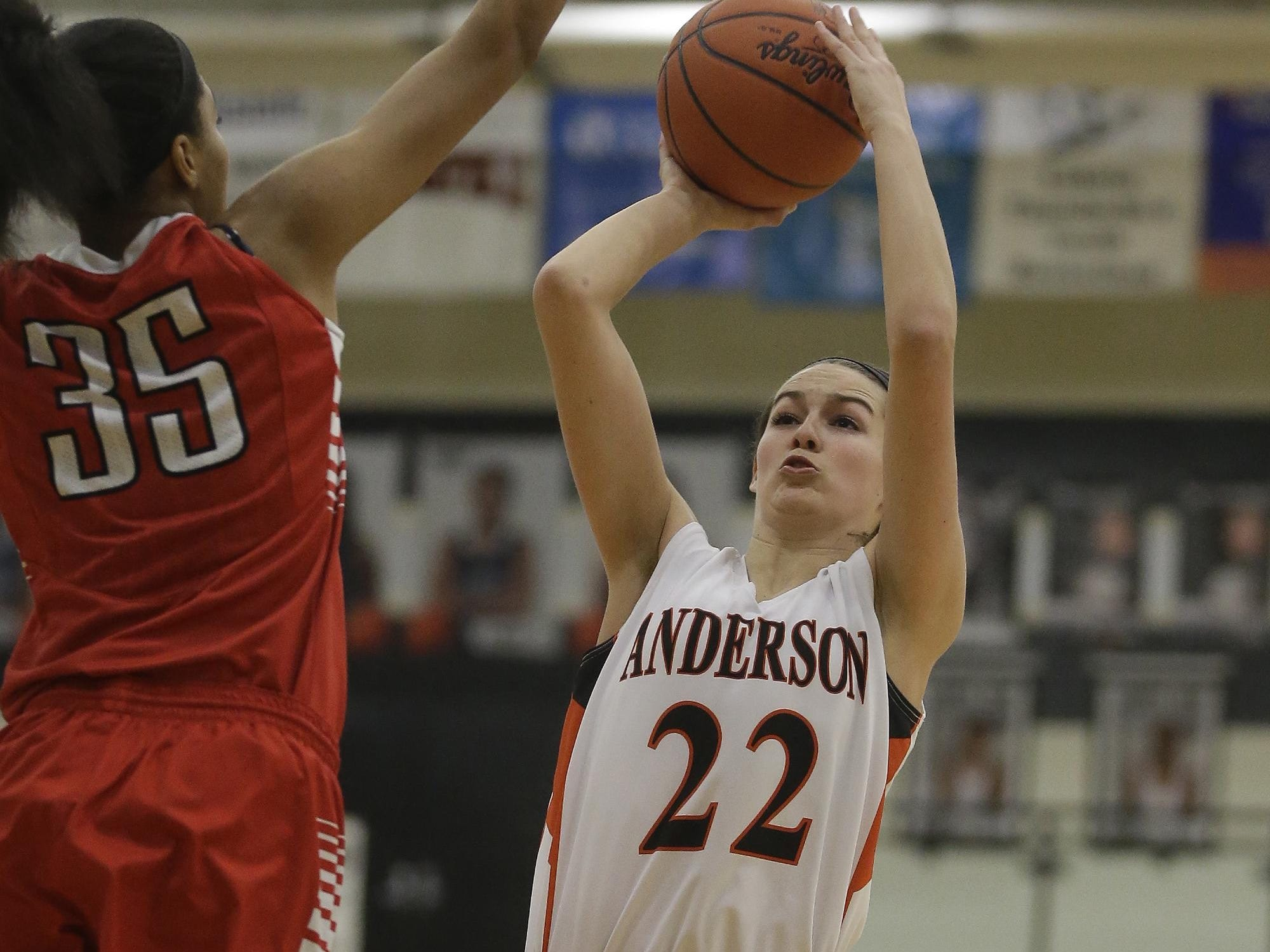 Anderson's Madison Temple shoots the ball over Fairfield's Anaiah Williams.