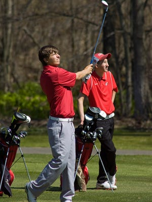 Canton's Donnie Trosper launches a shot Tuesday at Fox Hills while teammate Noah Lindlbauer watches.