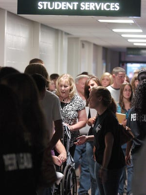 Freshman students line up to obtain student IDs at Sussex Technical High School in August 2008.