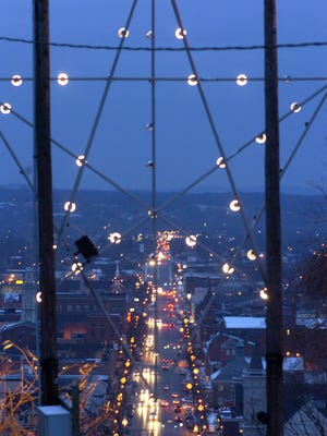 Motorists travel along Main Street under the star on Carlisle Hill in this file photo from 2005.